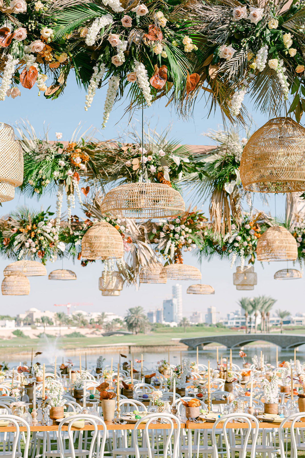 outdoor reception tables with overhead floral decor