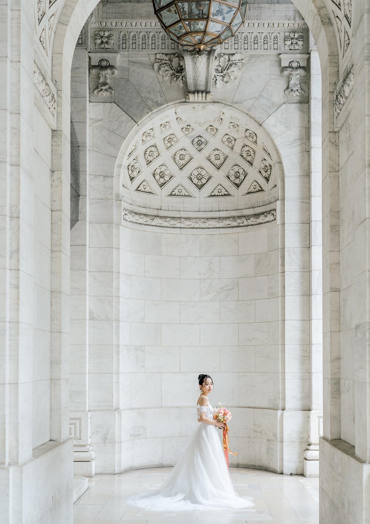 bride posing in new york public library