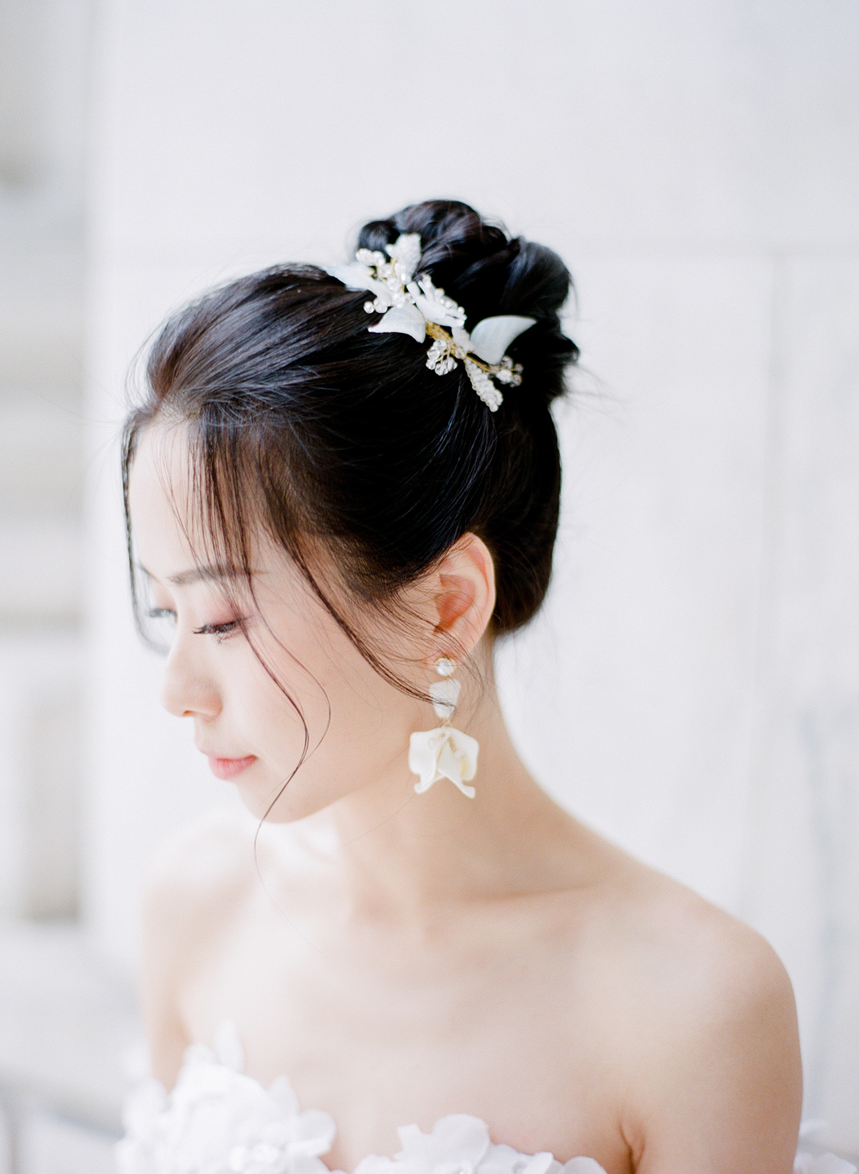bride close up portrait with white floral accessories