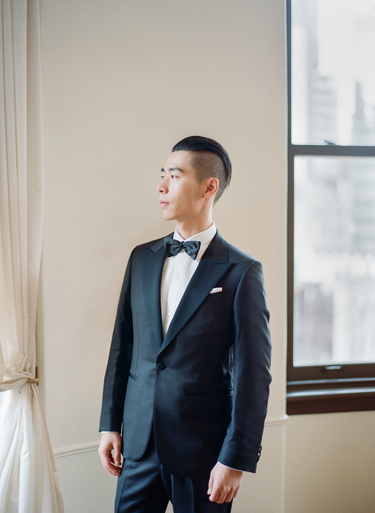 groom in black tux with bowtie