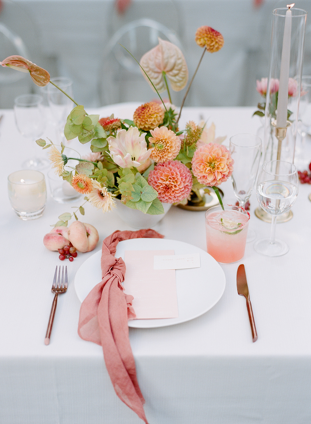 peach and coral wedding place setting with florals