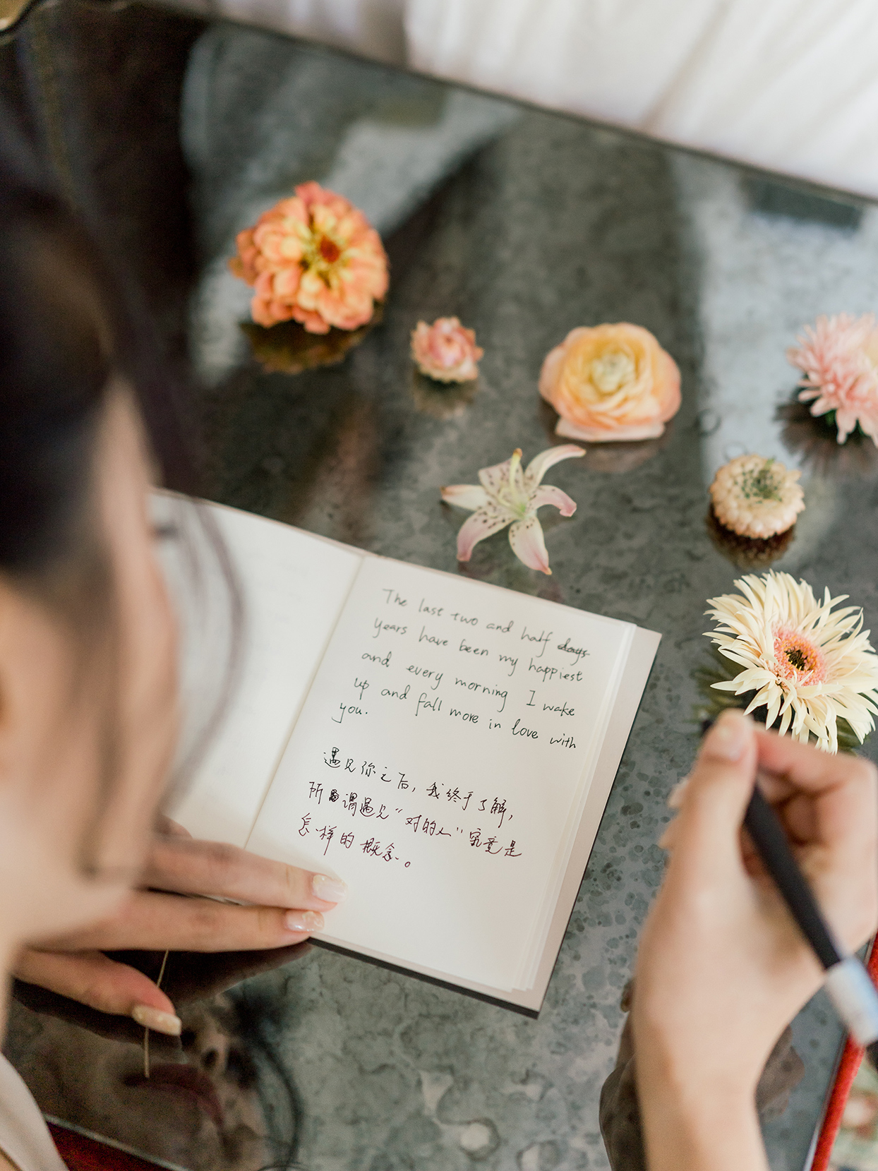 bride writing in vow book