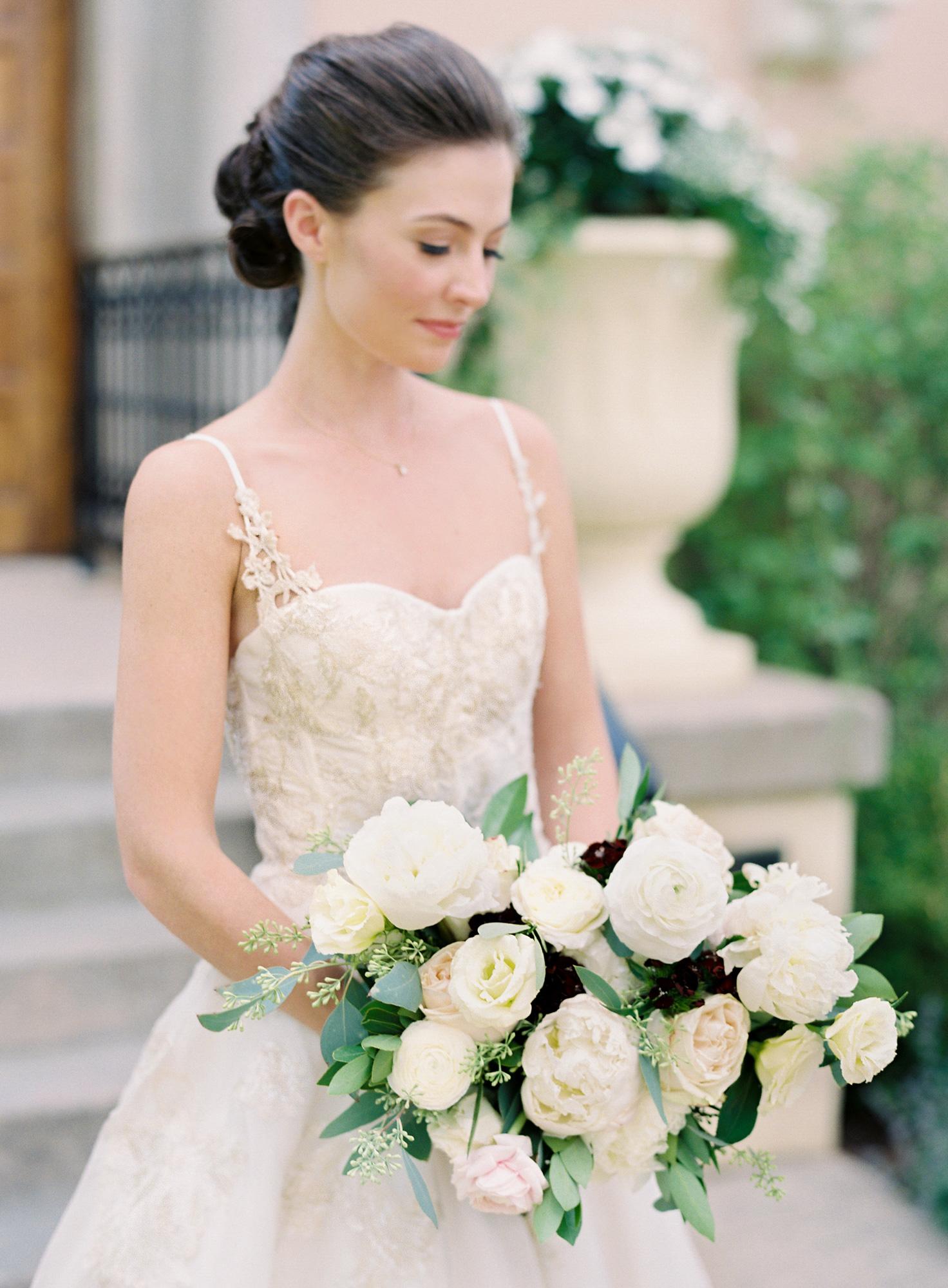 portrait of bride holding bouquet