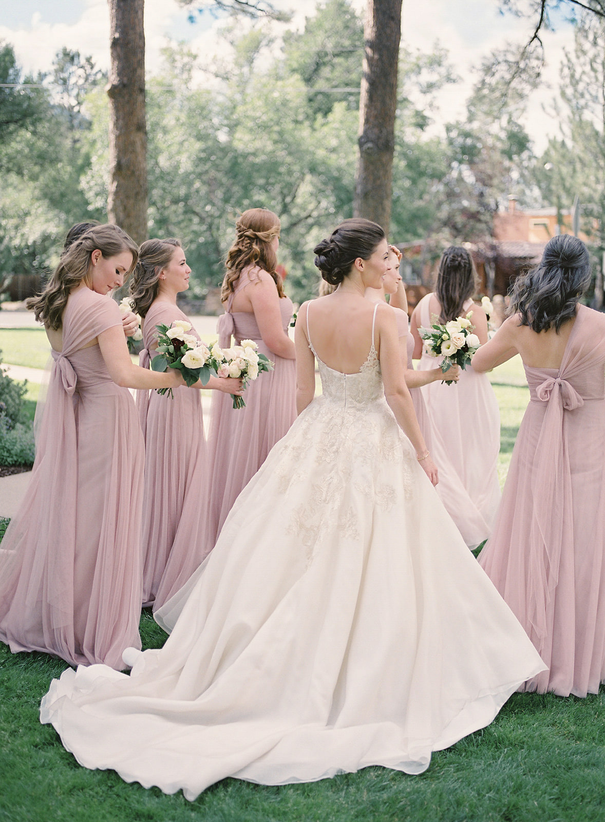 outdoor portrait of Hillary from back with bridesmaids