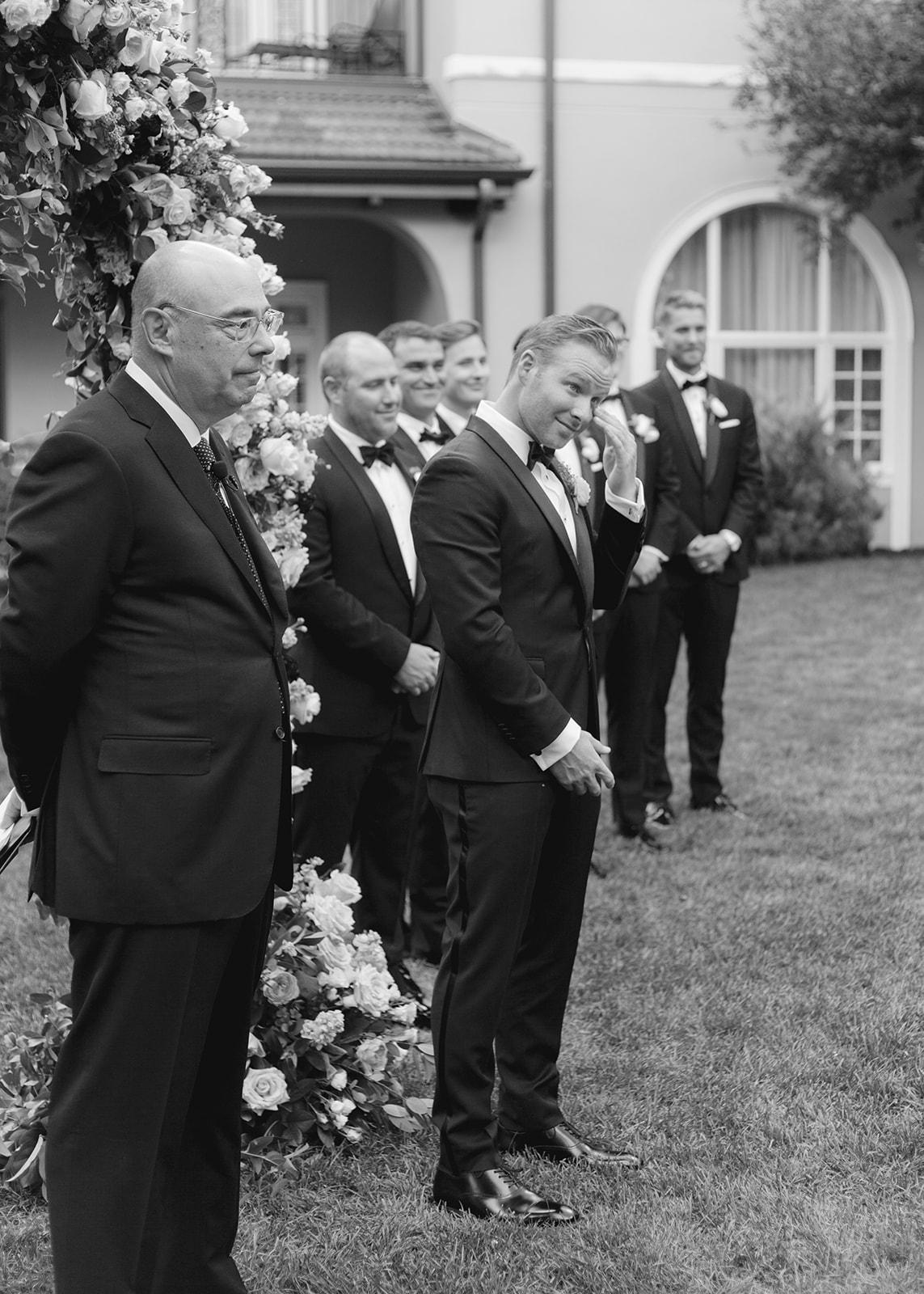 black and white photo Erik at altar with groomsmen