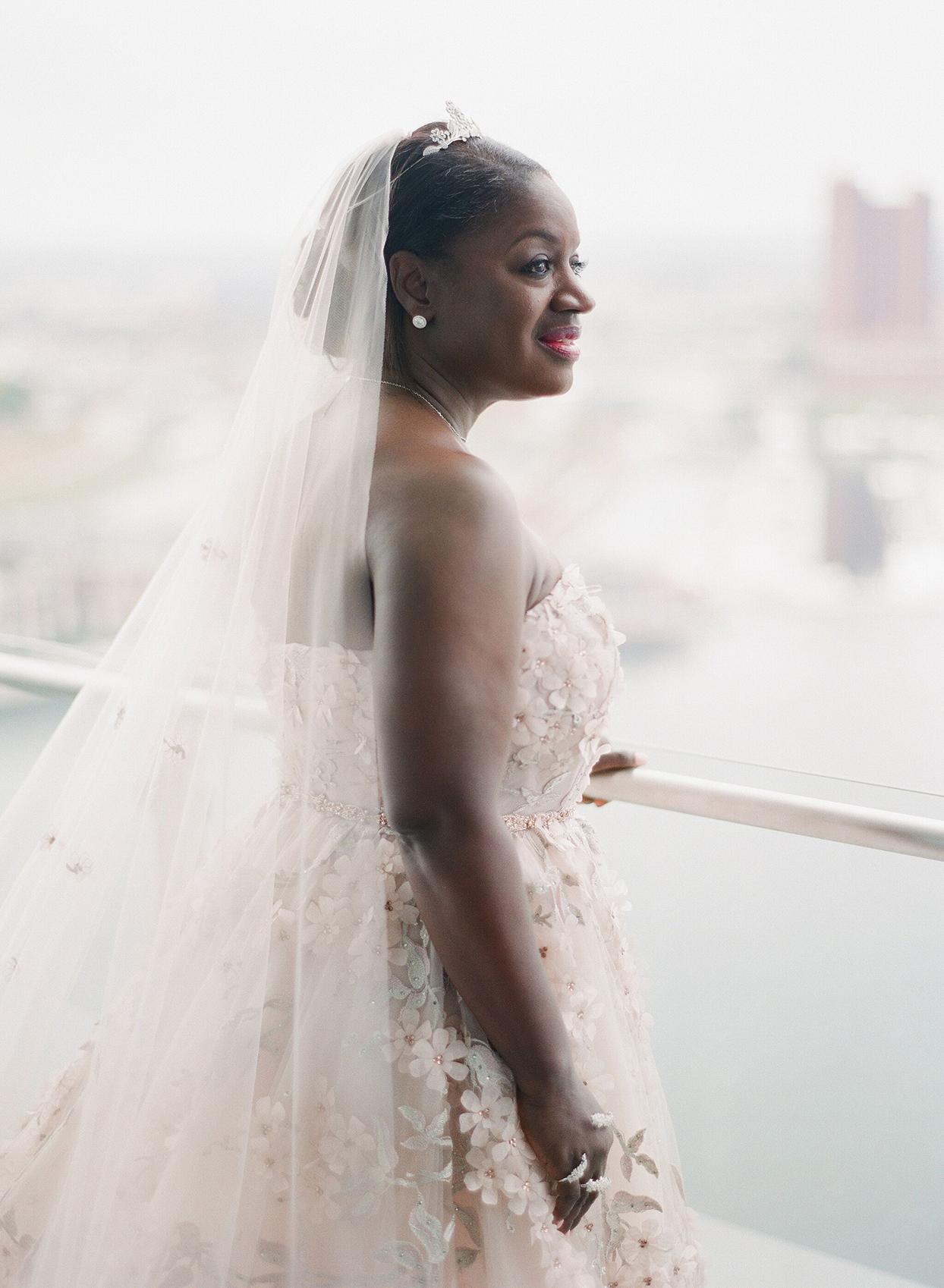 bride in pastel pink floral wedding dress