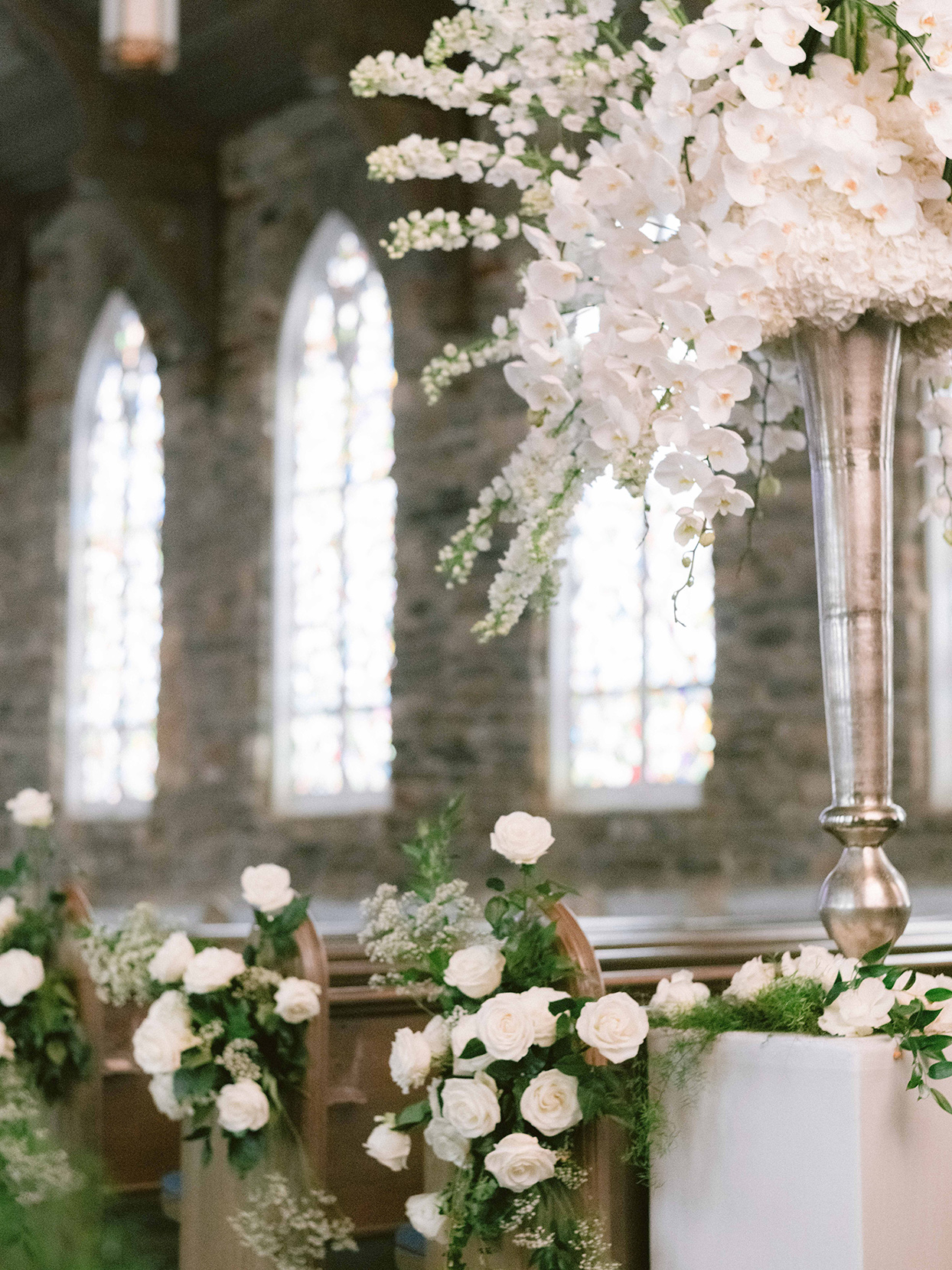 elegant church decorated in white flowers for wedding