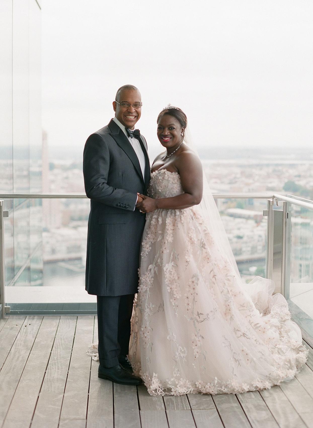 wedding couple portrait on balcony overlooking baltimore