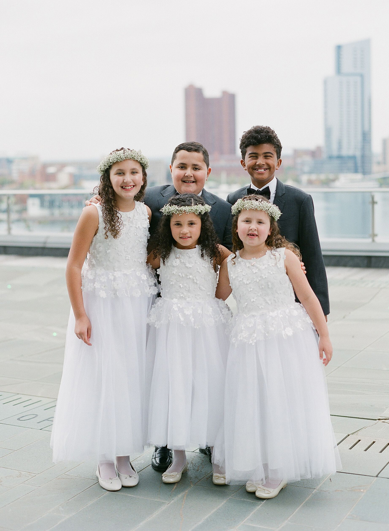 girls dressed in white and boys dressed in black for wedding