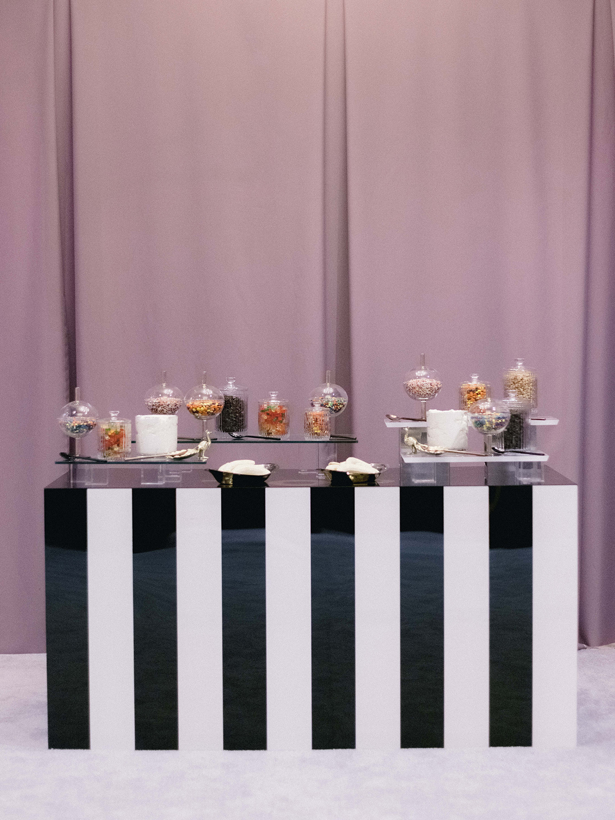 wedding reception candy table with striped black and white front