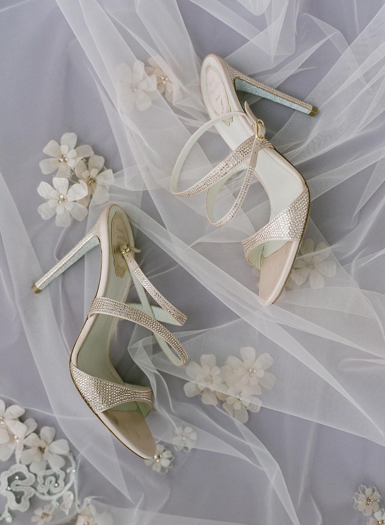 bride's pastel pink bejeweled wedding shoes