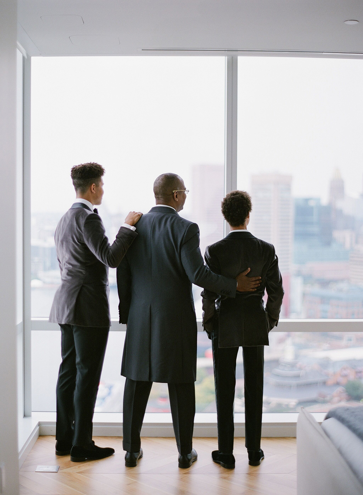 groom standing with sons overlooking the city