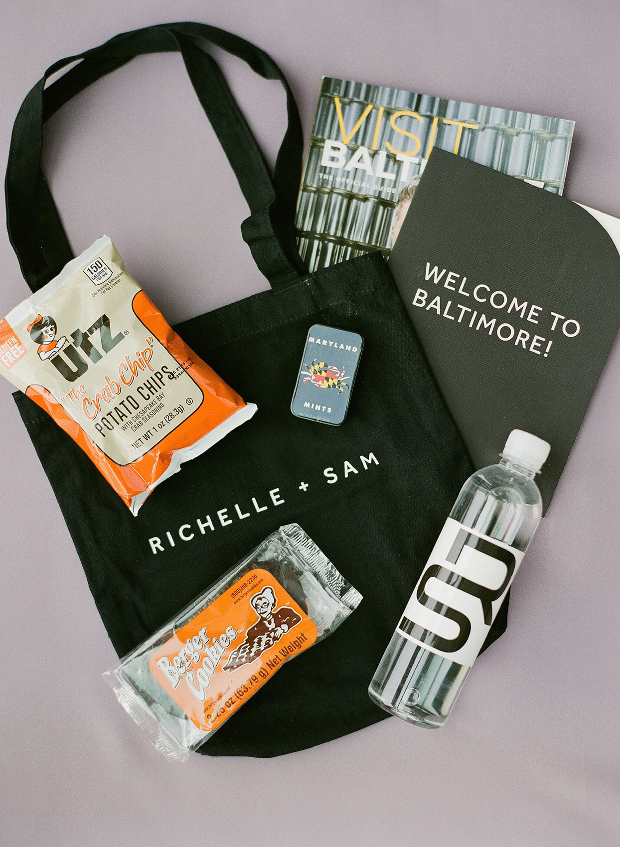 wedding welcome bags with local treats, monogrammed water bottle, and visitor's guide
