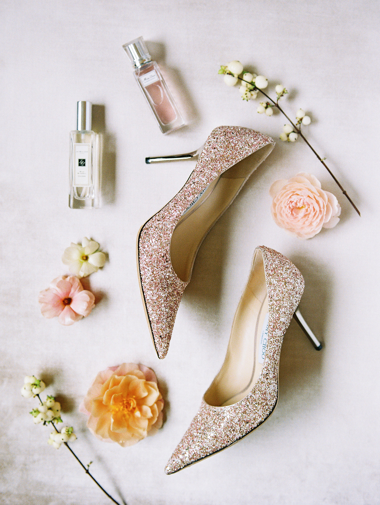 bride's pastel pink glittering shoes and accessories