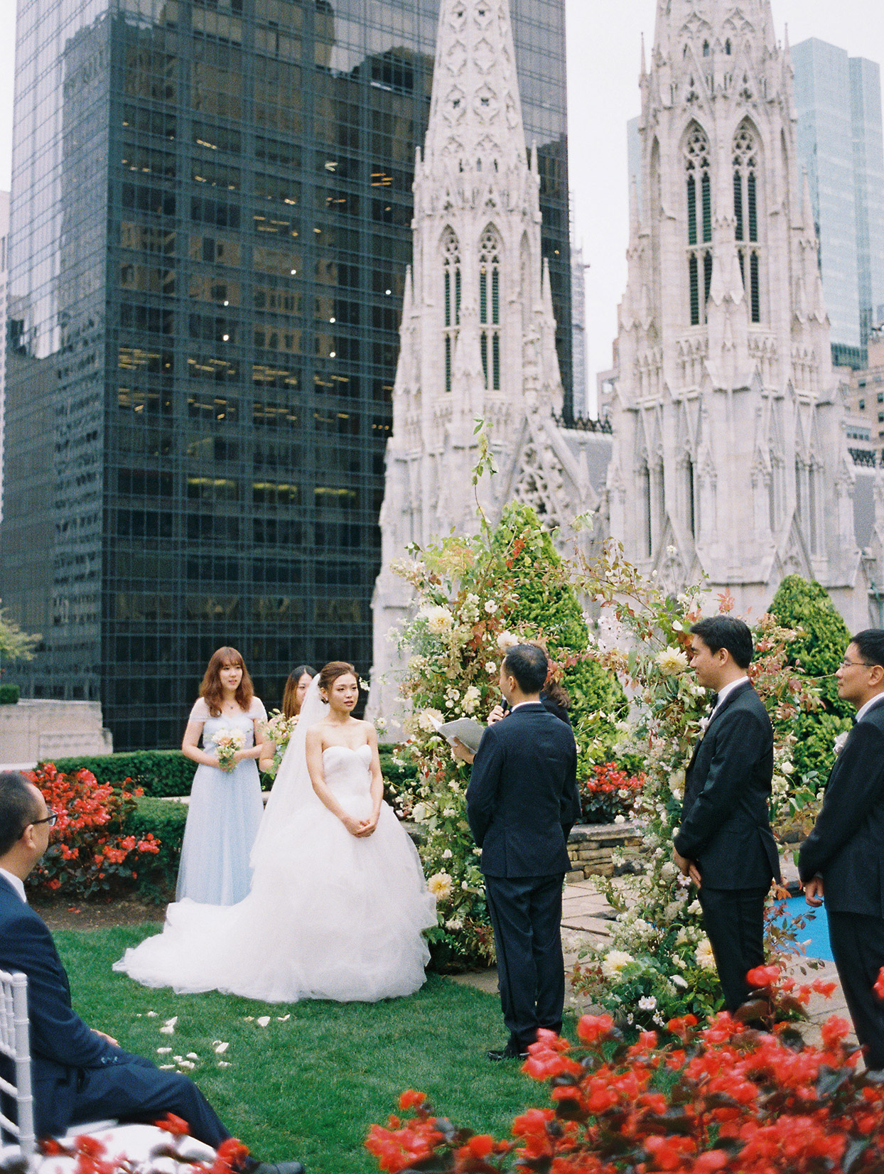 wedding couple saying vows during rooftop ceremony