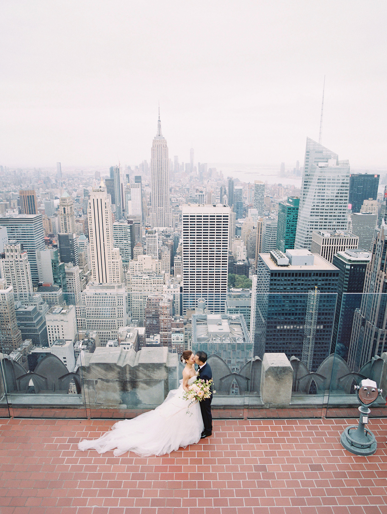 wedding portrait couple on top of Rockefeller Center with nyc view