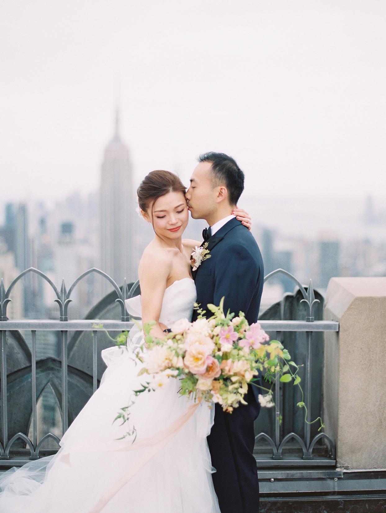 wedding couple portrait kiss on rooftop