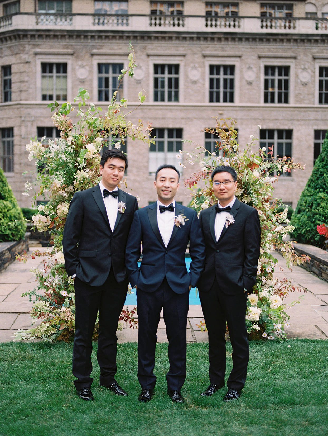 groom and groomsmen on rooftop