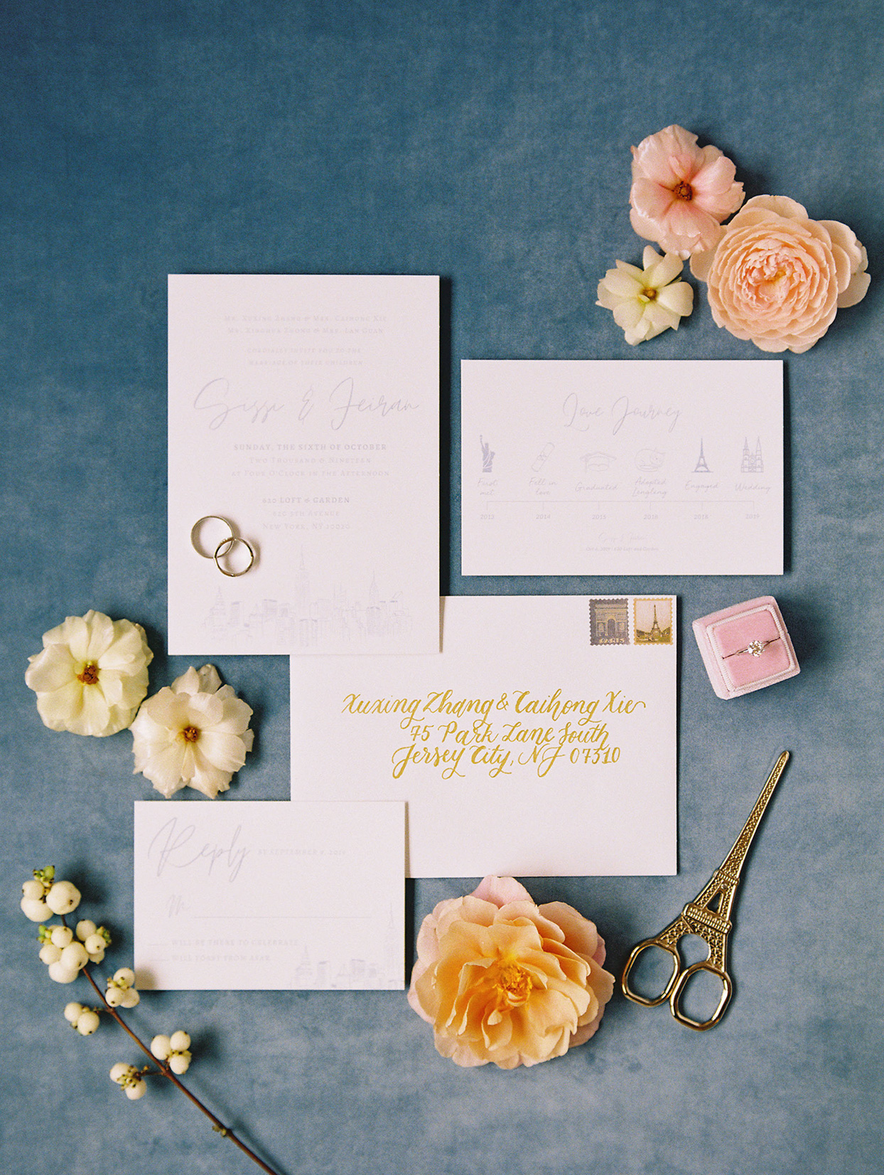 white and gold wedding invitation suite