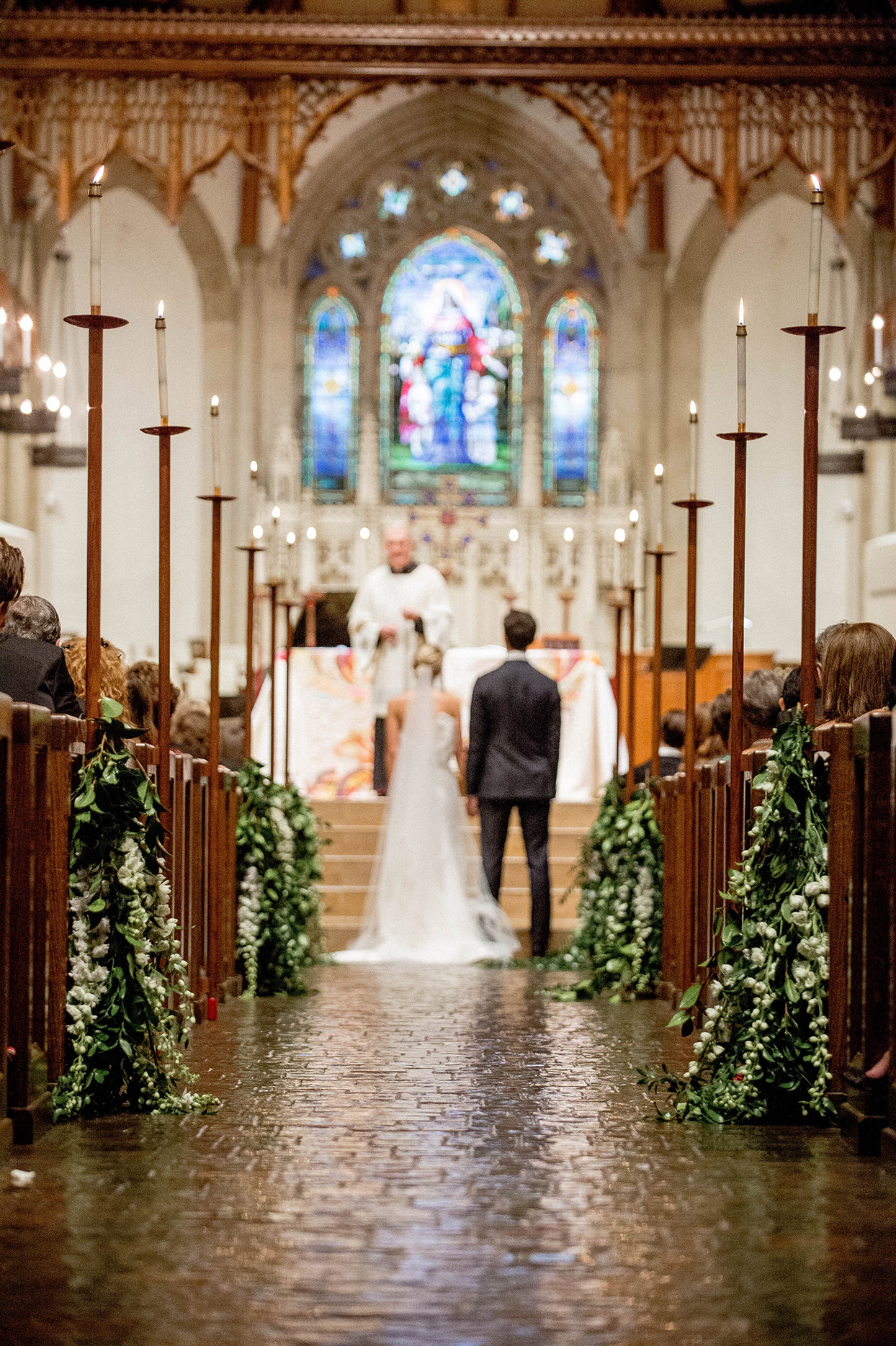 couple standing at altar inside traditional church