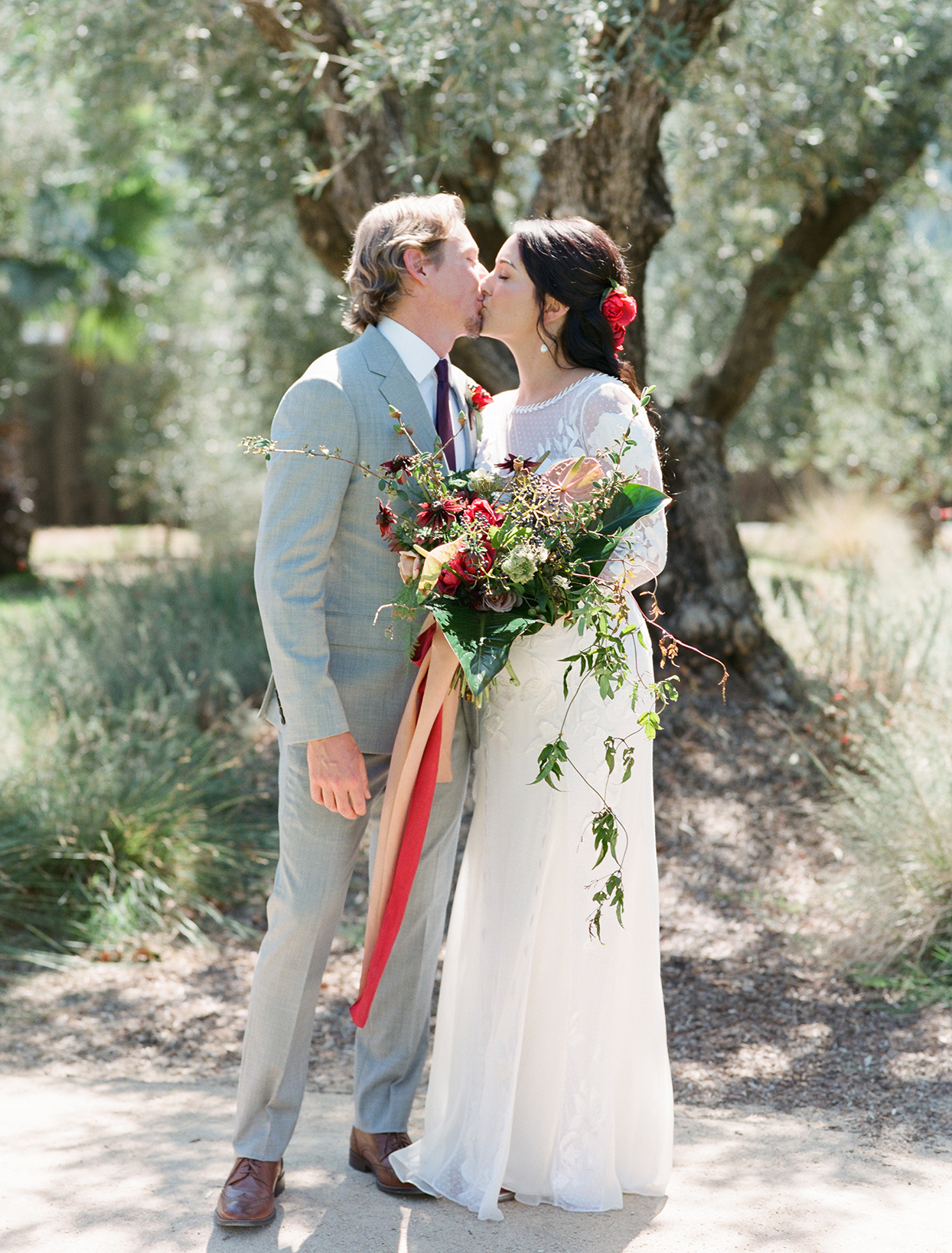 wedding couple kissing in natural setting