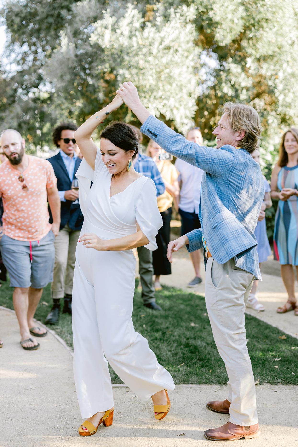 wedding couple dancing at reception in casual attire