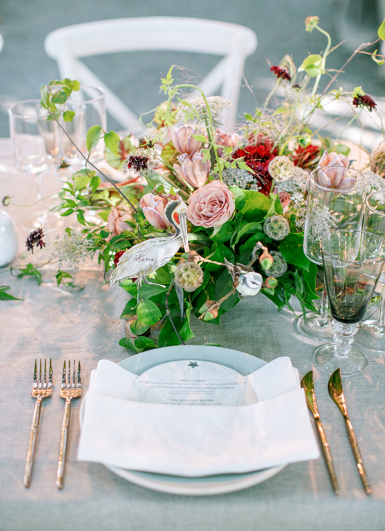 reception place setting with elegant utensils and floral centerpiece