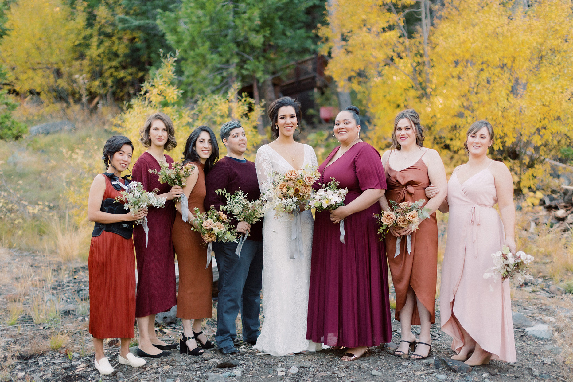 bride and bridesmaids in assorted fall colors