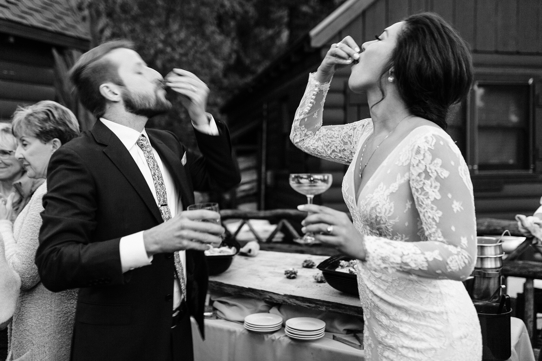 bride and groom eating oysters during reception