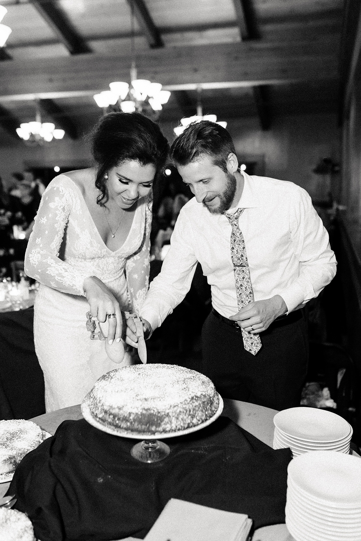 bride and groom cutting wedding cake at reception