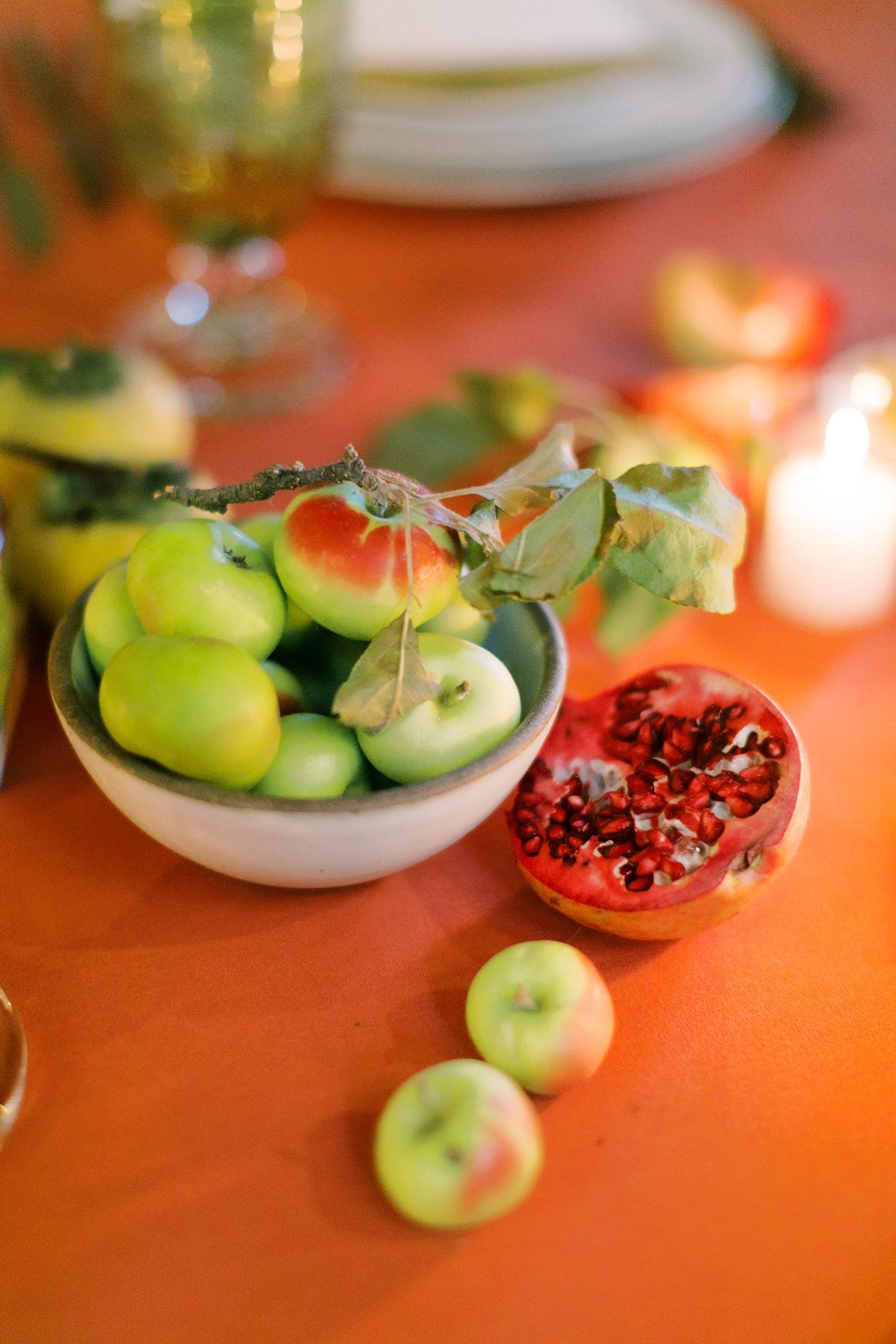 wedding reception decorative fruit on orange table cloth