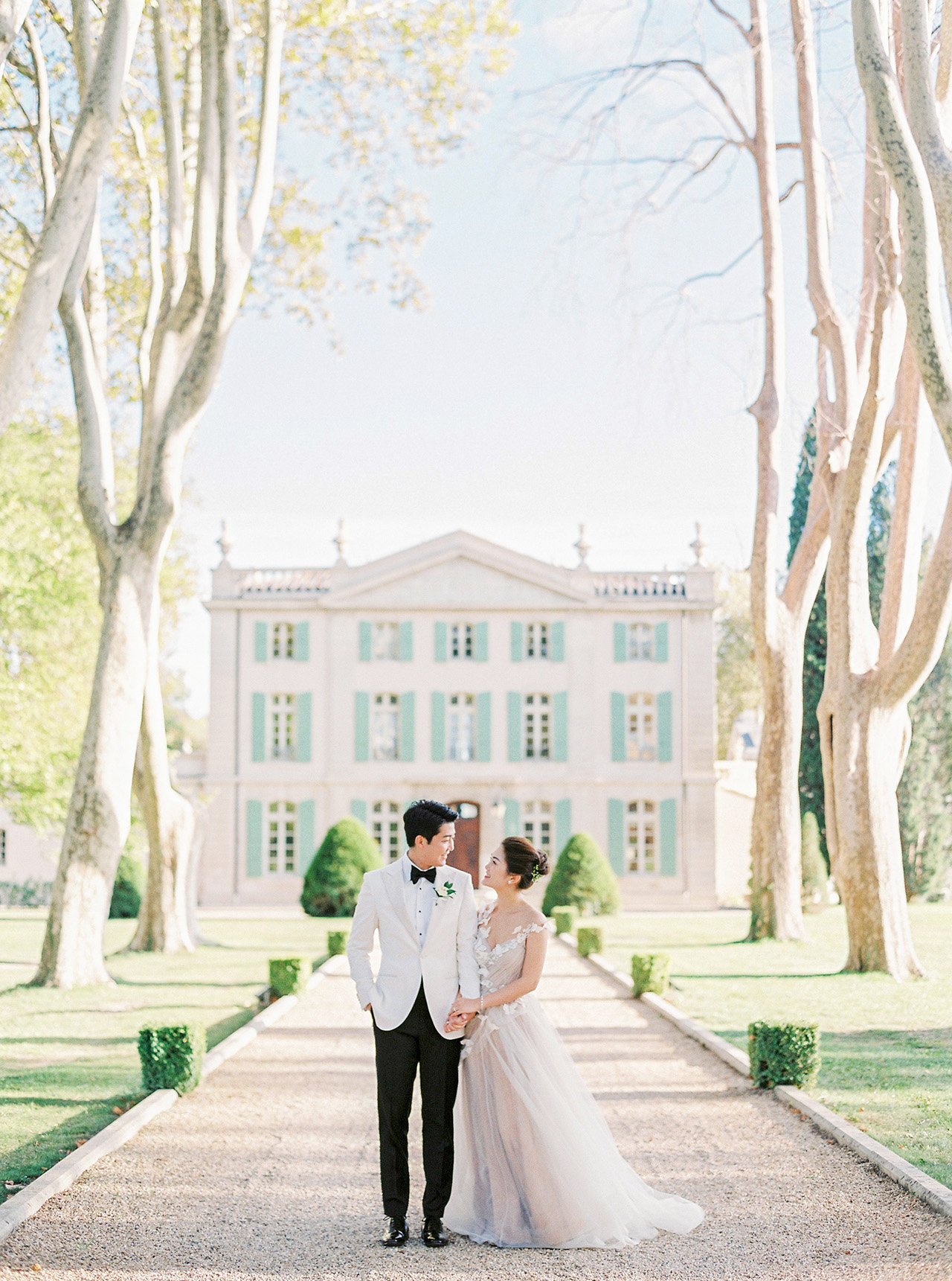 nancy sangho wedding couple in front of chateau