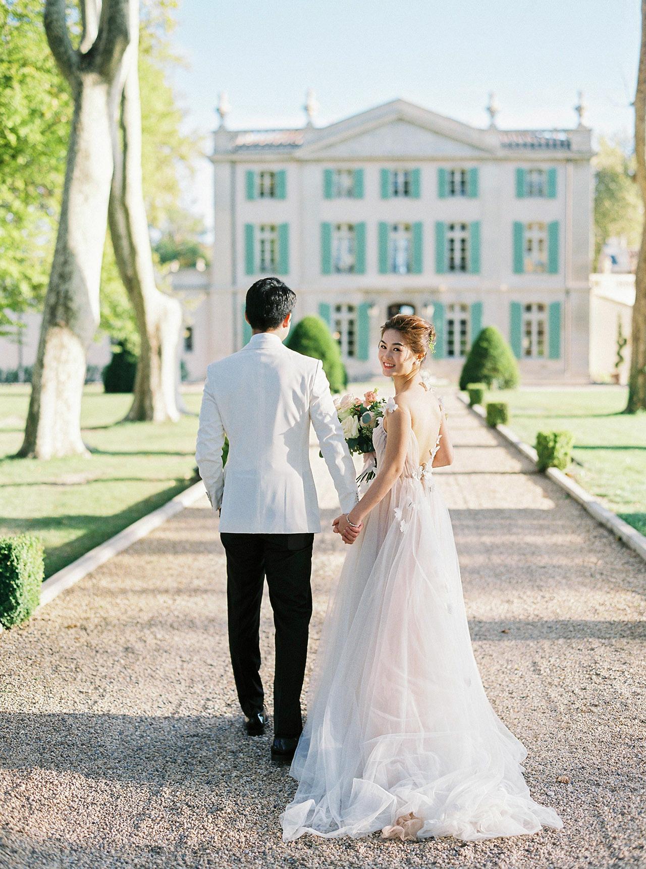 nancy sangho wedding couple walking