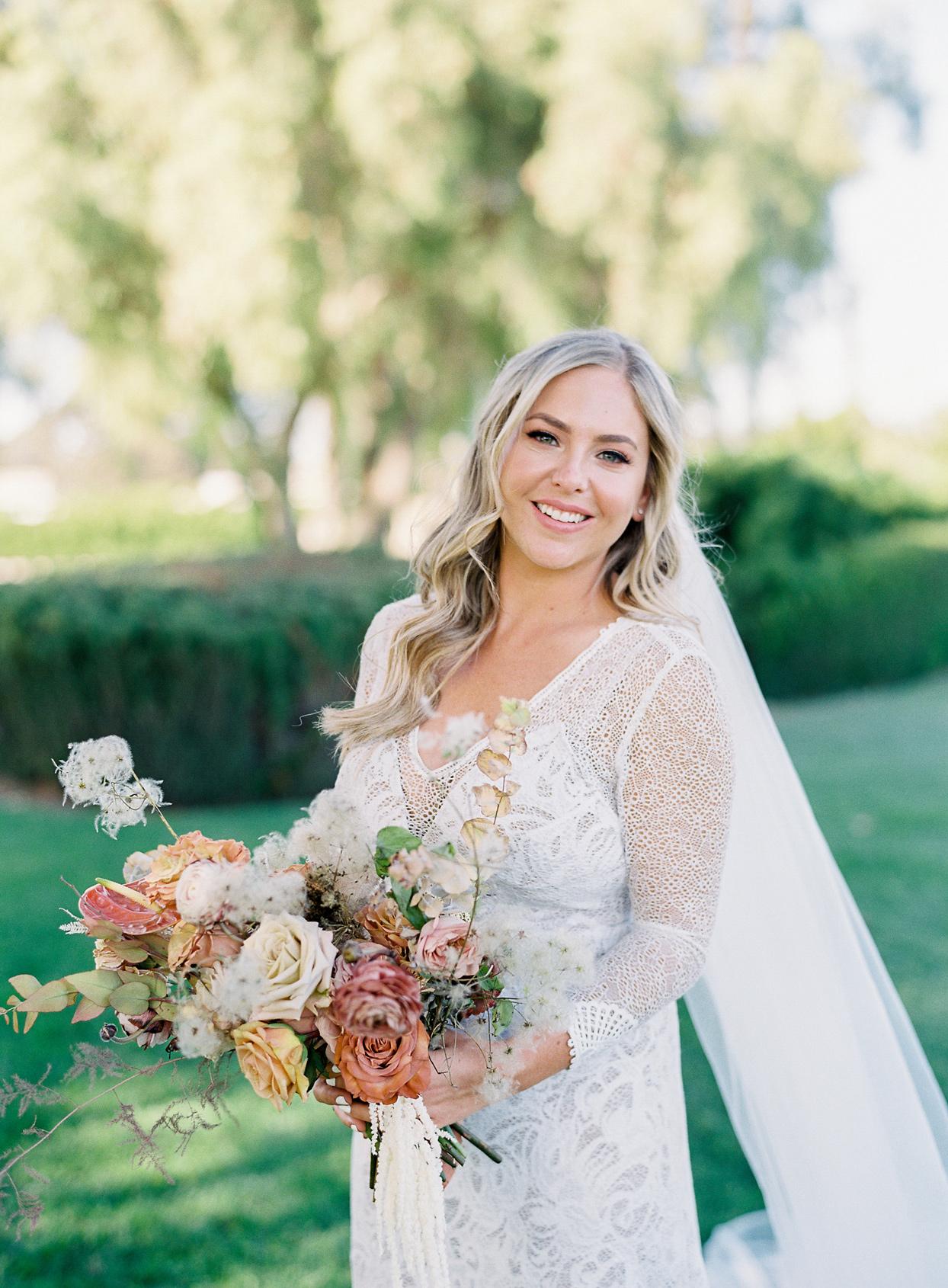 portrait of bride holding wildflower bouquet