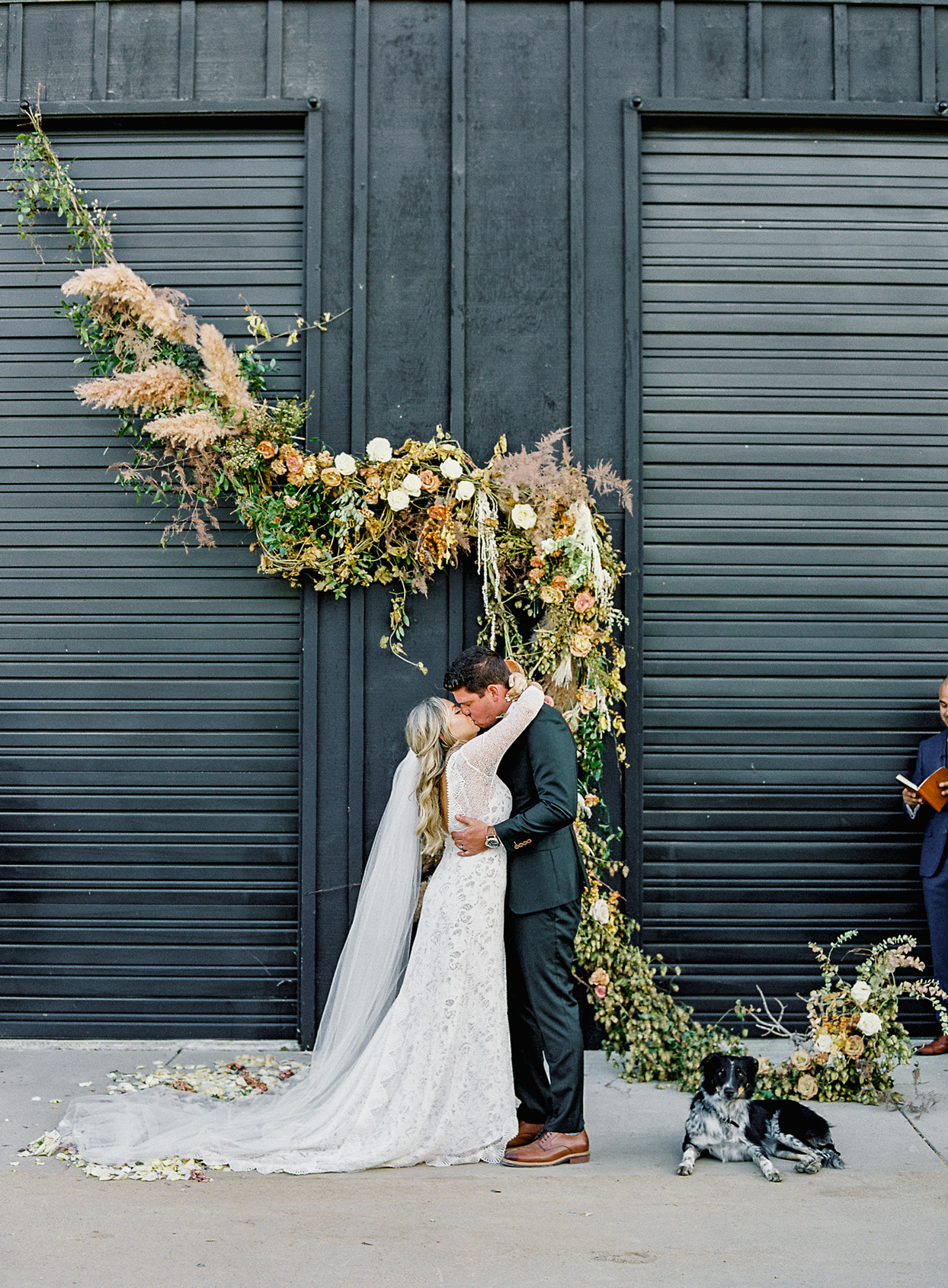 bride and groom sharing ceremonial kiss