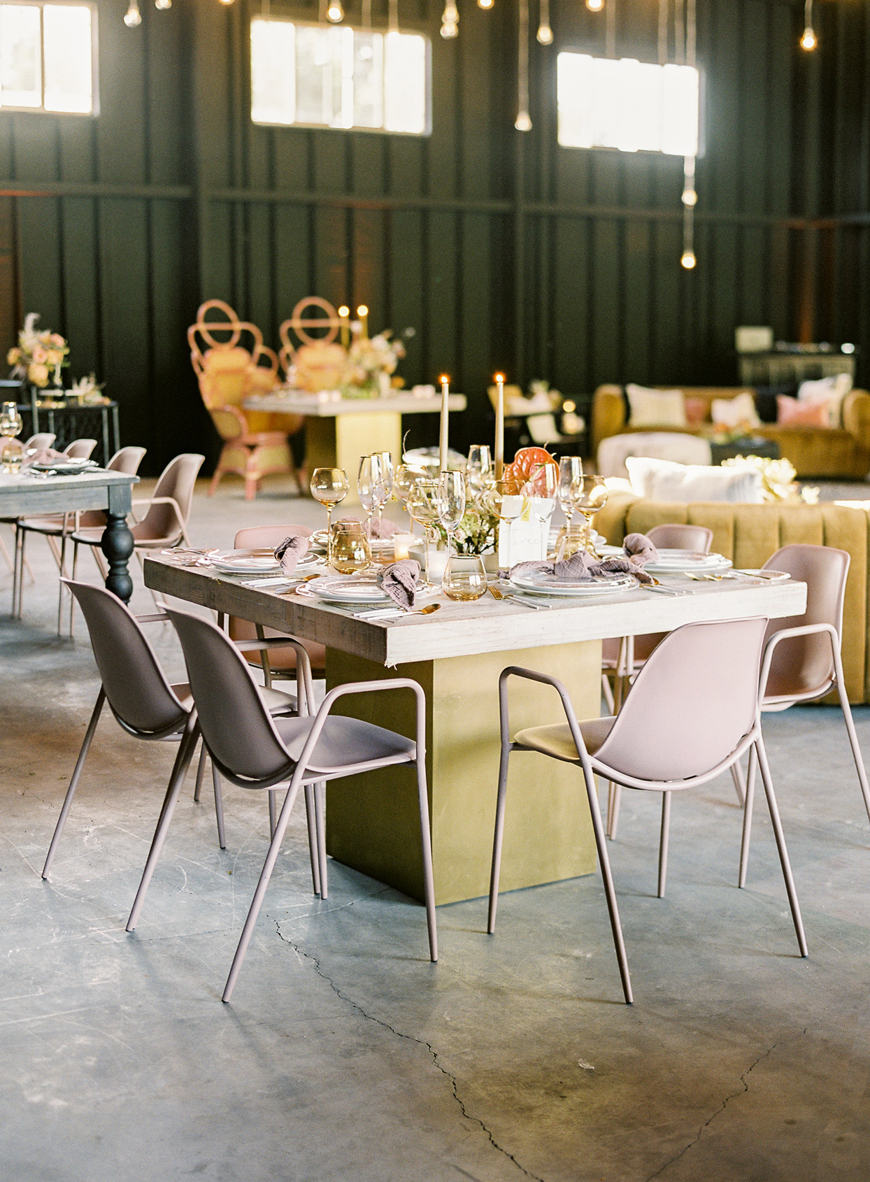 square wooden wedding reception table with blush chairs