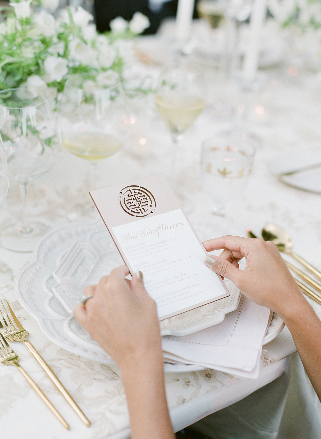 Wedding reception place settings with plates with scalloped edges