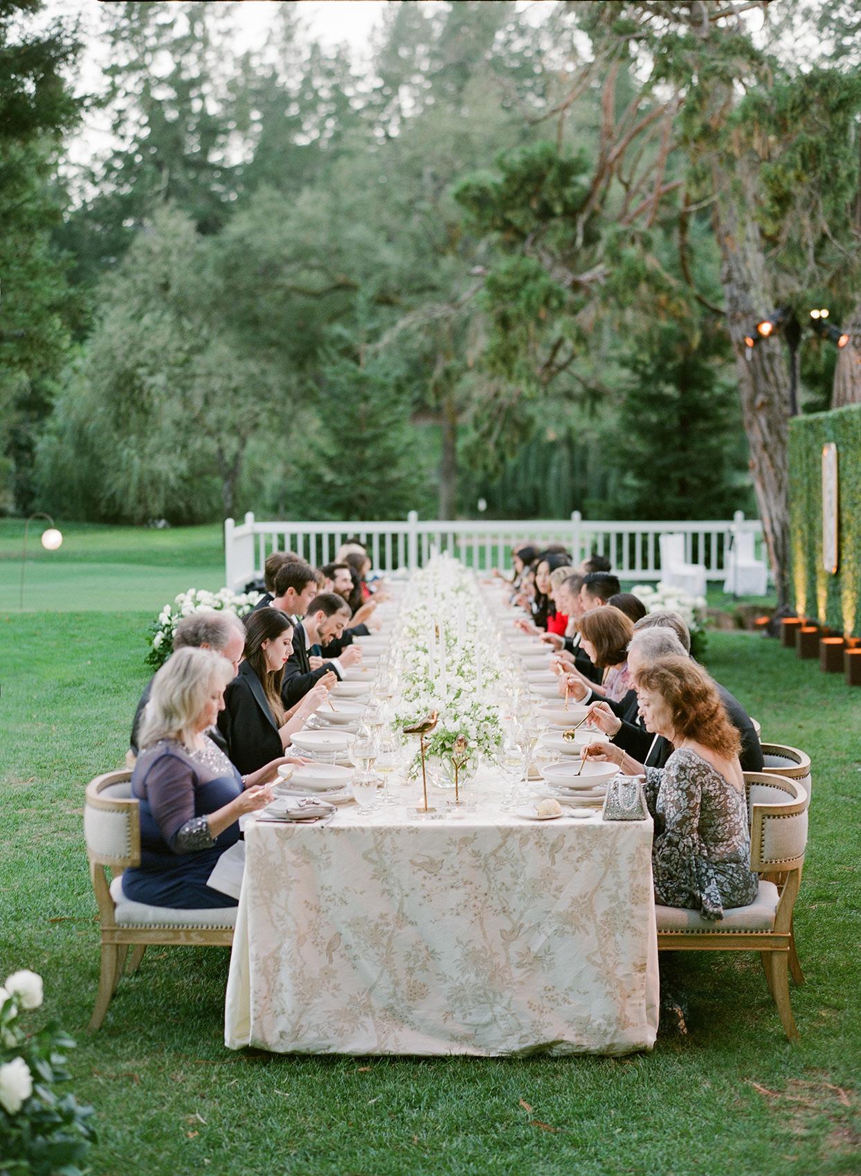 Wedding reception table with custom Ralph Lauren table runner