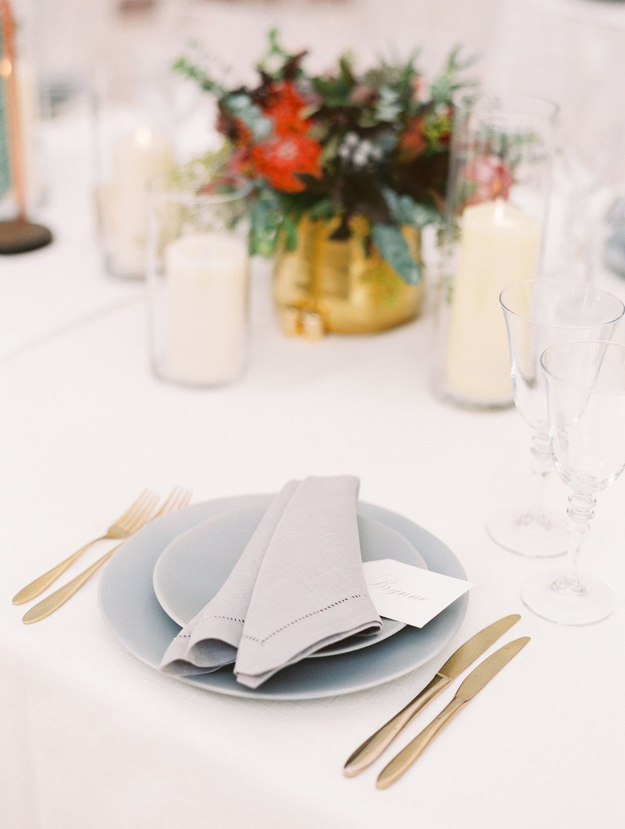 gray and gold reception place settings