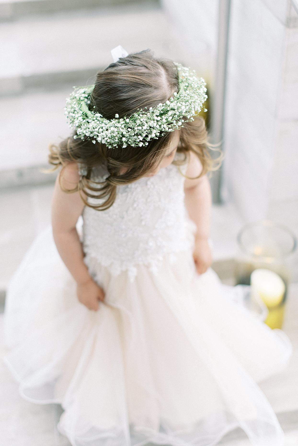 Flower girl wearing crown of baby's breath
