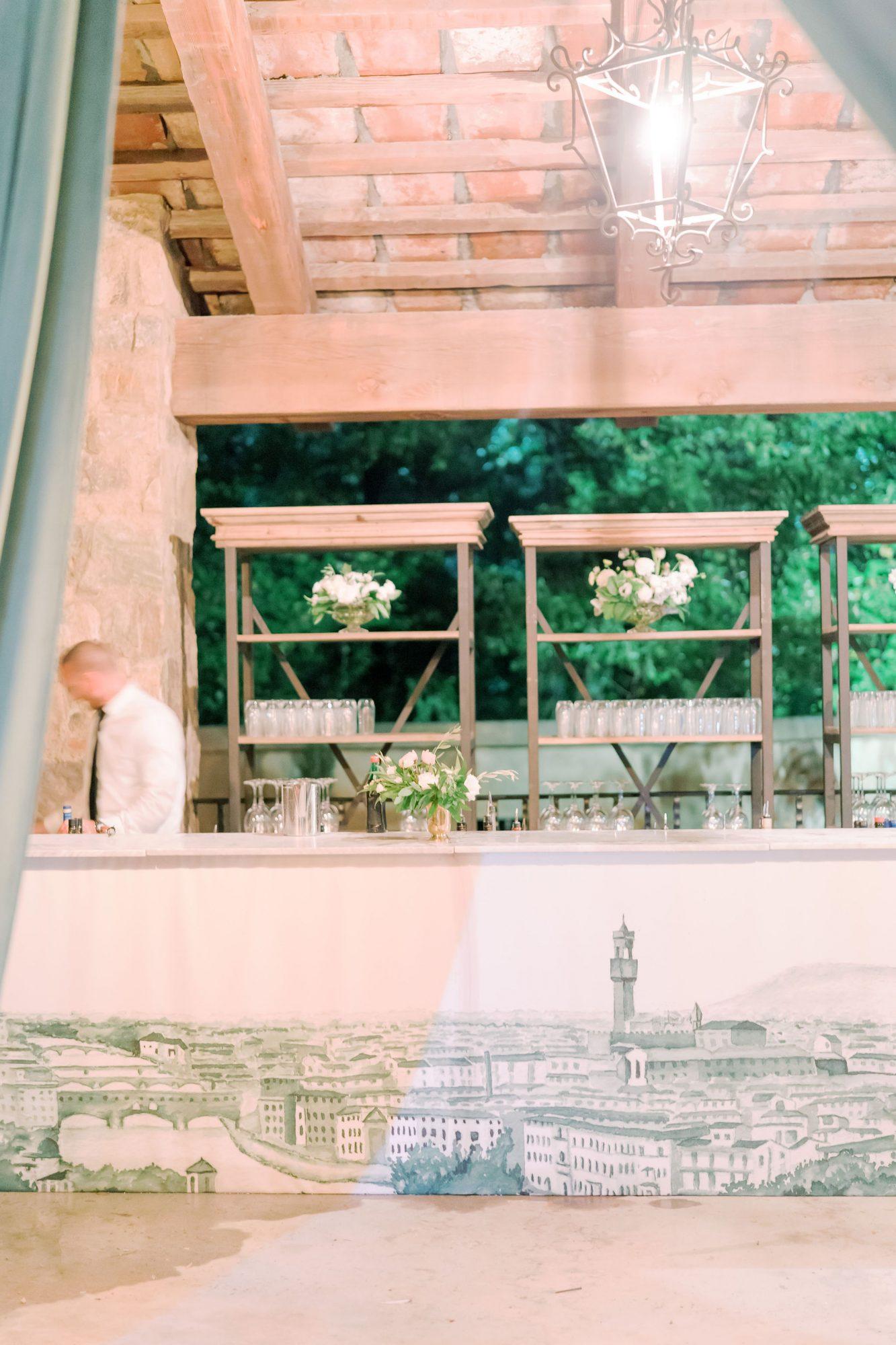 wedding reception bar with city mural