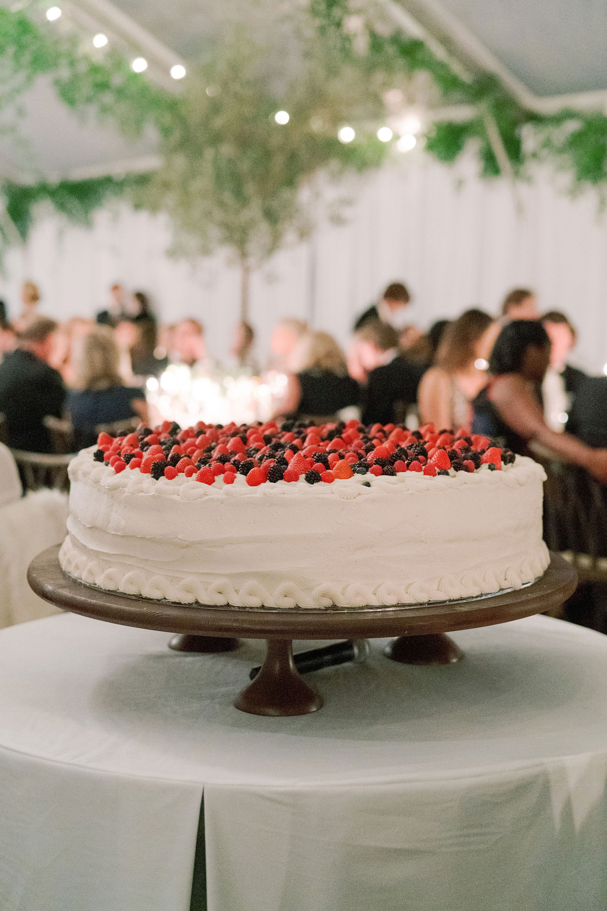 one tier white wedding cake topped with fresh berries