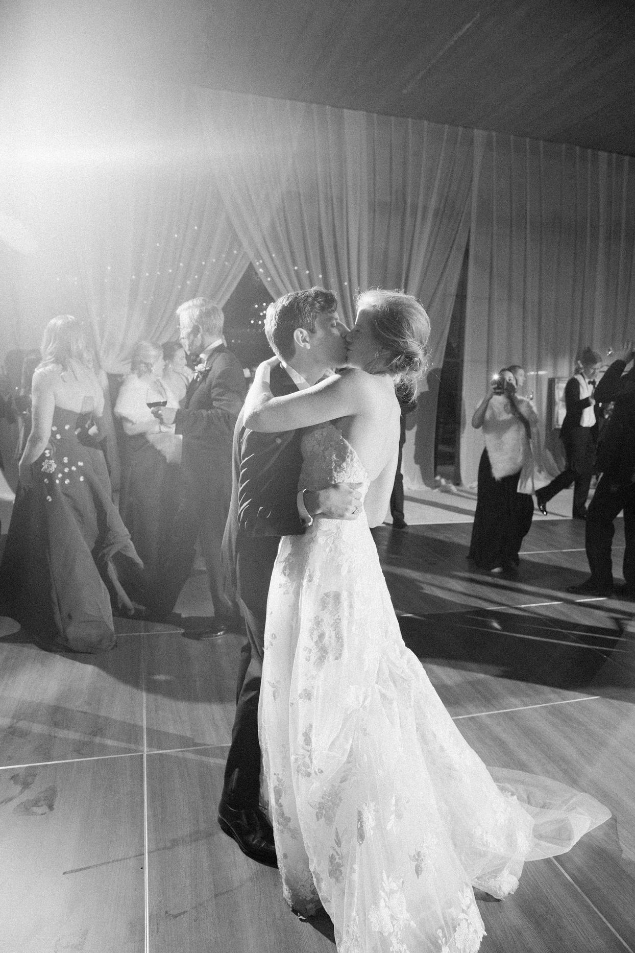 bride and groom share a kiss during first dance