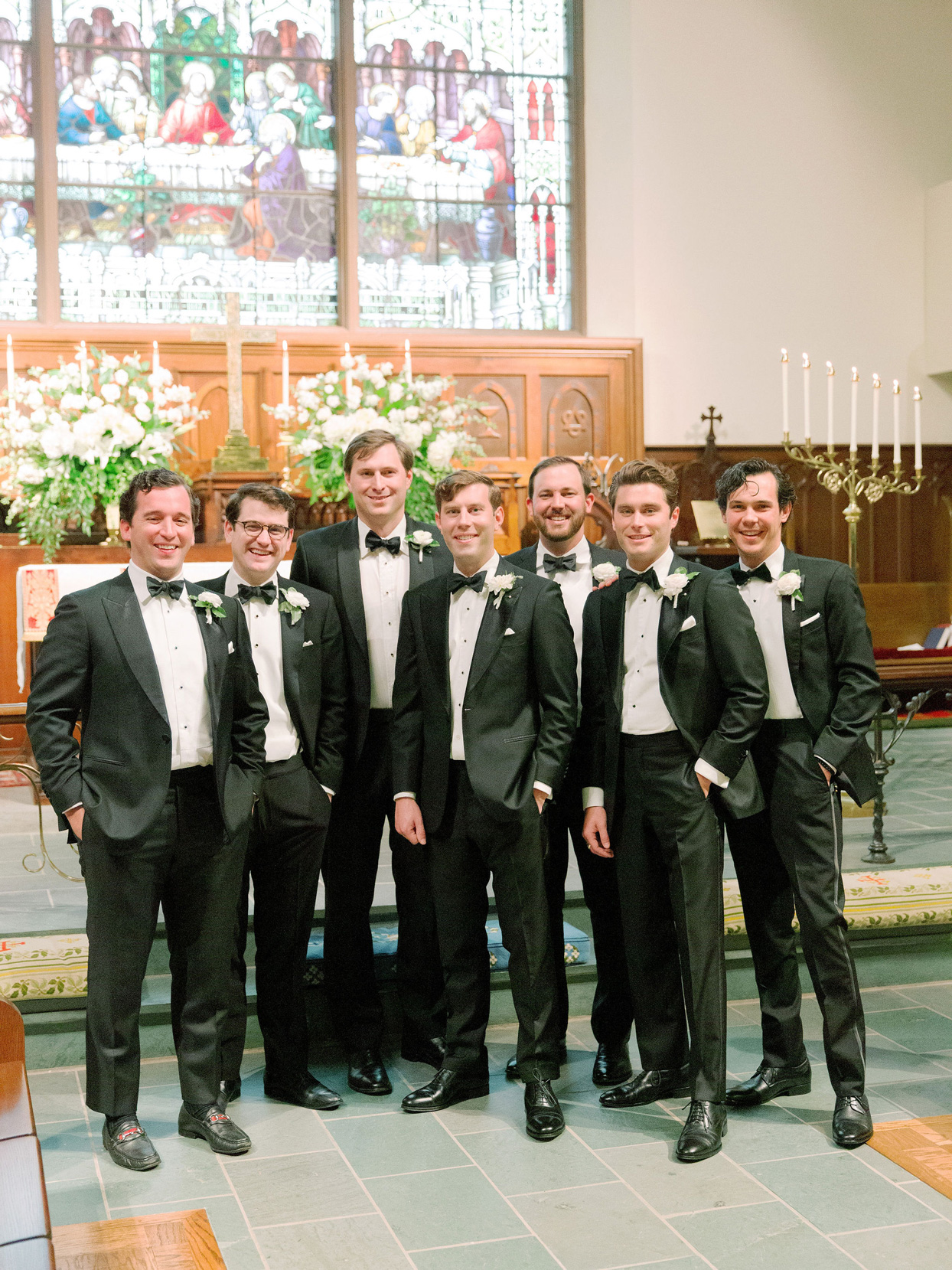 groom with groomsmen in classic black suits