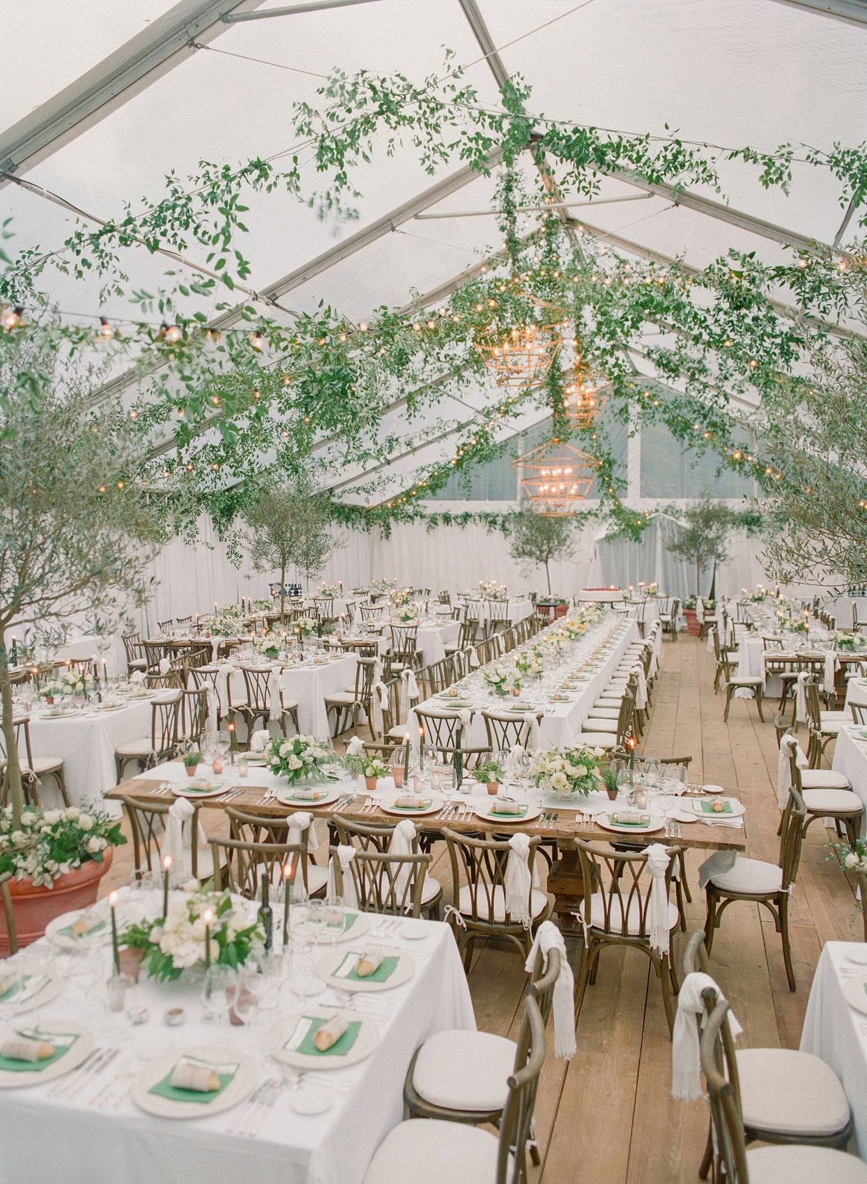 large wedding tent filled with greenery