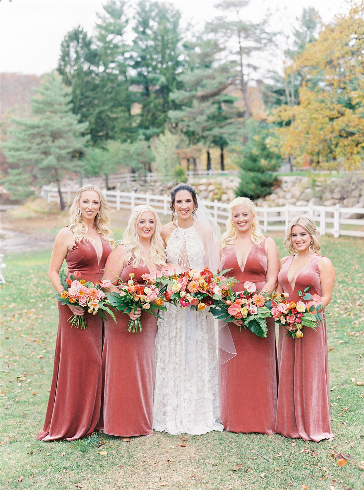 bride and bridesmaids in red dresses