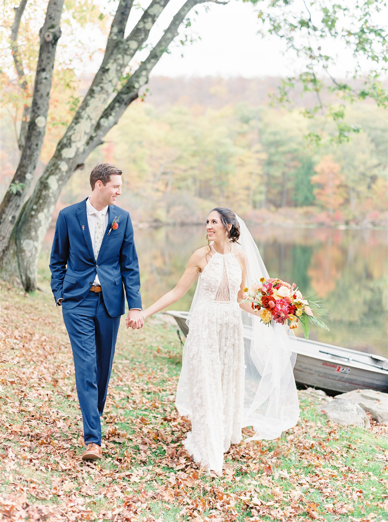 wedding couple walking together by lake
