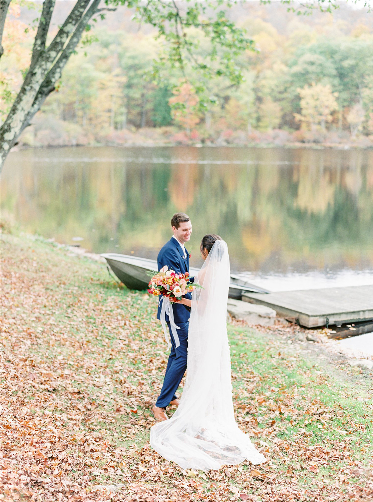wedding couple first look on banks of lake