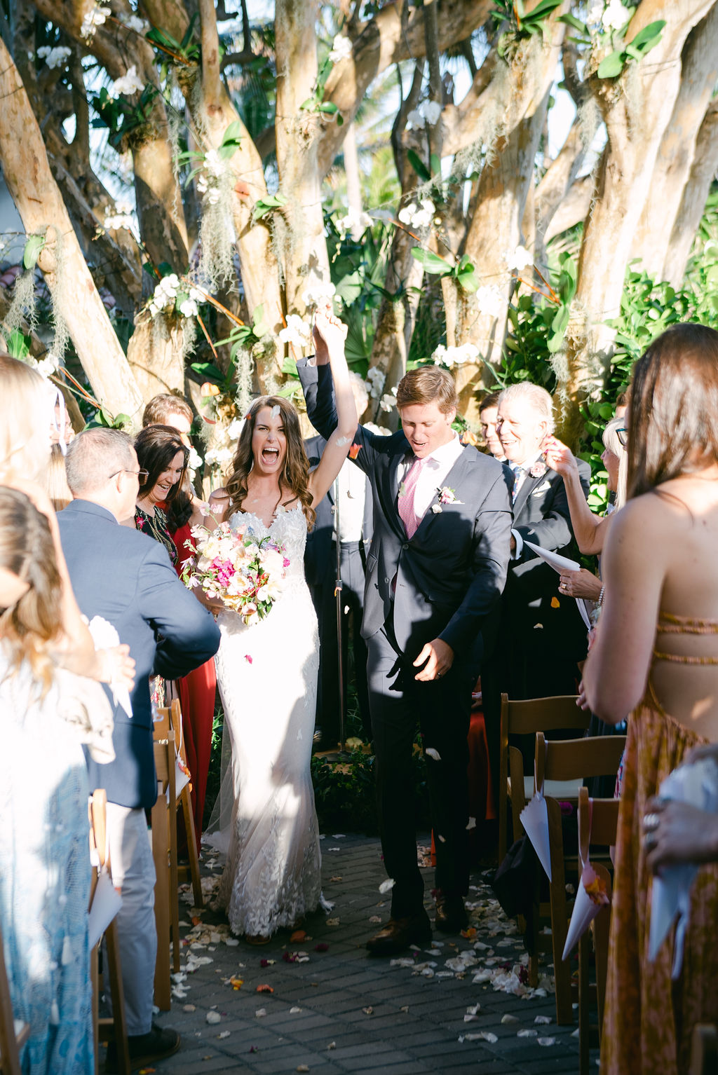 wedding couple celebrating as they leave ceremony