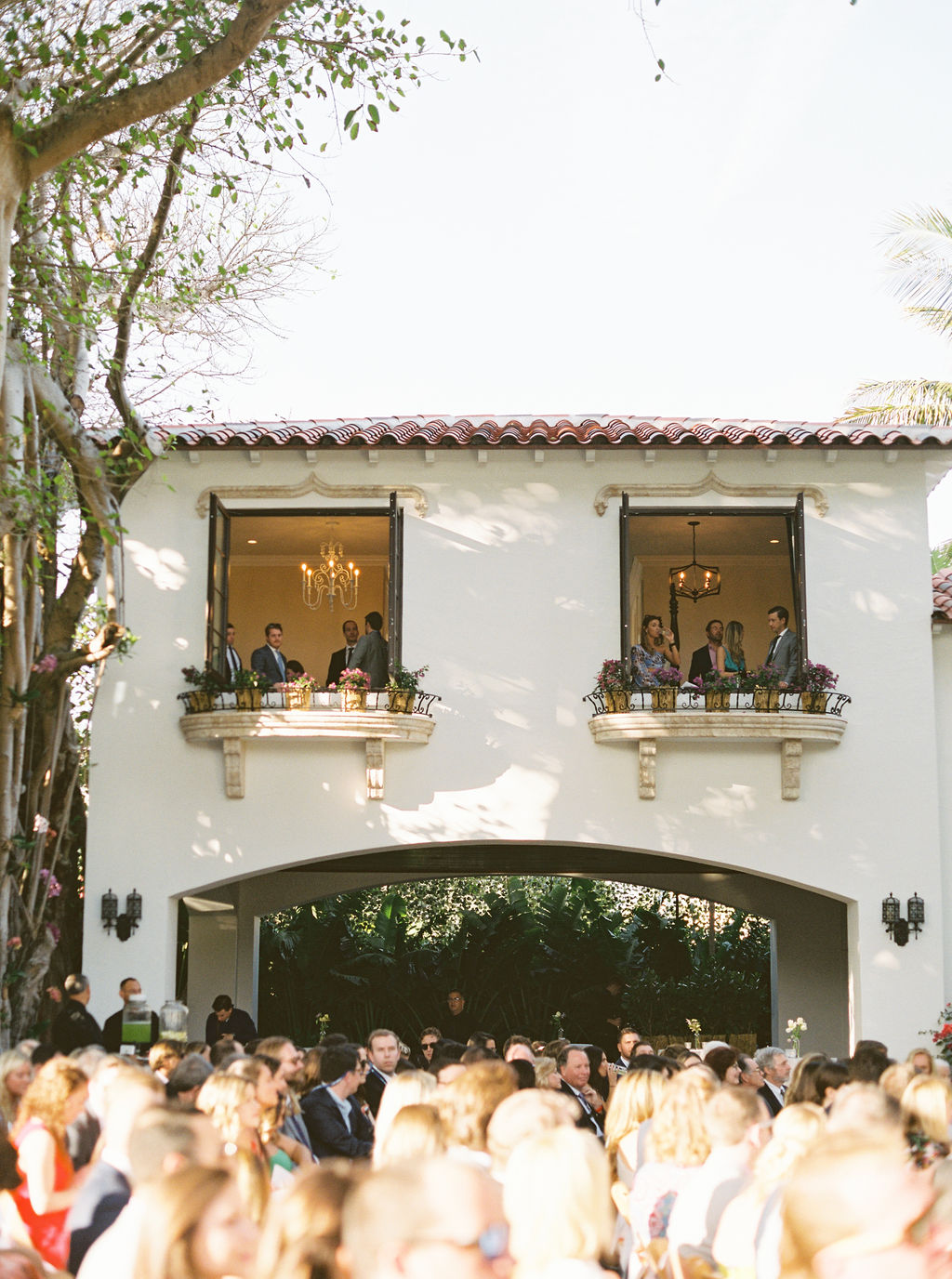 elegant wedding house with guests milling around
